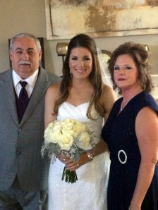 Me with my parents on my wedding day
